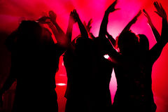 People dancing in club with lightshow Royalty Free Stock Photo