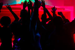 People dancing in club with lightshow Stock Photography