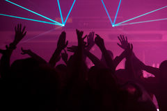 People dancing in club with lightshow Royalty Free Stock Photos