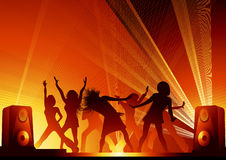 People_dancing_in_the_disco_lights Photographie stock