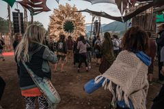 People dancing early in the morning in the main stage of the Lost Theory psytransce music festival