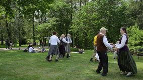 People dancing folk dances in pairs in park folk event stock video footage