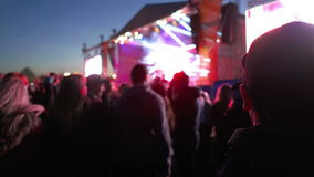 People Dancing in front of the Stage. Large group of people dancing and enjoying the musical festival stock video footage