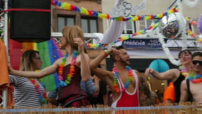 People dancing in gay truck platform in slow motion stock video footage