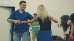 People dancing in the hall. Several couples dancing in the hall, 4K stock video footage