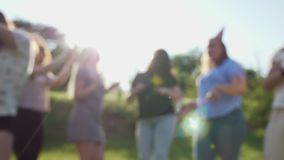 People are dancing and having fun. Blurred background stock footage