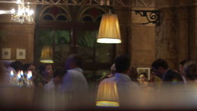 People are dancing while having a good time together at a bar