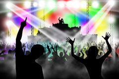 People dancing in night club. DJ playing music Royalty Free Stock Photos