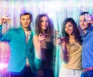 People dancing at night club Stock Photo