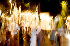 People dancing. Under the light Royalty Free Stock Photo