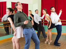 People dancing rock-and-roll. Smiling people dancing rock-and-roll in dancing class Stock Images