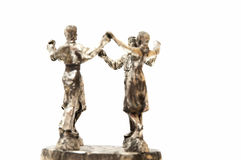 People dancing Sardana statue Stock Photos