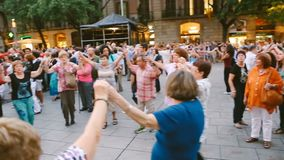 People are dancing on the street in plaza Barcelona Spain. Summer evening. Festivities. Editorial video footage. People are dancing on the street in plaza stock footage
