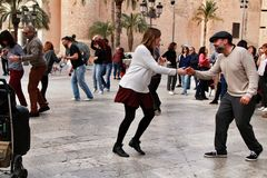 People dancing swing in the street royalty free stock images