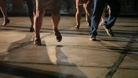 People dancing synchronous. At night stock video footage