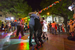 People dancing Tango in Buenos Aires, Argentina. BUENOS AIRES, ARGENTINA, NOVEMBER 17: Group of people dancing the tango at night on the main square of San Telmo royalty free stock photography