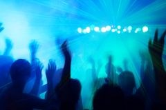 People dancing to the disco beat. People silhouettes dancing to the disco beat Royalty Free Stock Image