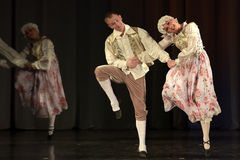 People dancing in traditional costumes on stage, Stock Photography