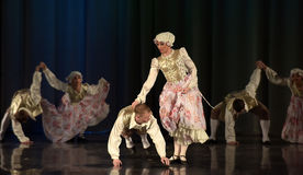 People dancing in traditional costumes on stage, Stock Photos
