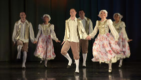 People dancing in traditional costumes on stage, Royalty Free Stock Image