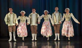 People dancing in traditional costumes on stage, Royalty Free Stock Photo