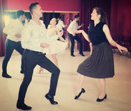 People dancing twist. Young positive people dancing twist in pairs Stock Image