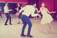 People dancing twist. Young positive people dancing twist in pairs Stock Photography