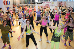 People dancing during Zumba training fitness at a gym Royalty Free Stock Photos