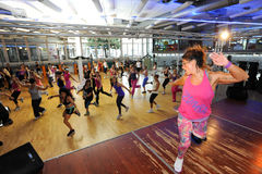 People dancing during Zumba training fitness at a gym Royalty Free Stock Photography