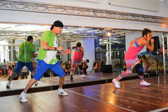 People dancing during Zumba training fitness at a gym Stock Photos