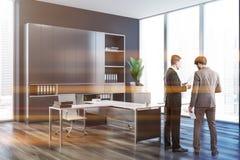People in dark gray ceo office interior stock photo