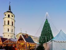 People at decorated Christmas tree and souvenir Xmas market Vilnius Royalty Free Stock Image