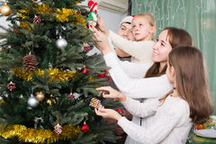 People decorating Christmas tree Royalty Free Stock Images