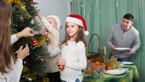 People decorating Christmas tree Stock Photography