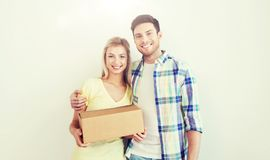 Smiling couple with box moving to new home Stock Photos