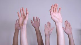 People democracy vote teamwork concept. crowd of people raised lifestyle their hands up expressing agreement and support. Volunteering or voting teamwork stock footage