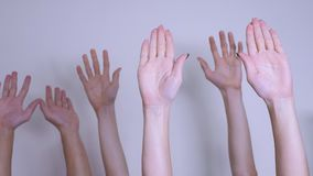 People democracy vote teamwork concept. Crowd of people raised their hands up expressing lifestyle agreement and support. Volunteering or voting teamwork stock video footage