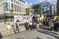 People demonstrate against murder and violation of kurdish peopl. FRANKFURT, GERMANY - AUGUST 9, 2014: people demonstrate against murder and violation of kurdish Royalty Free Stock Image