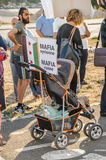 People denouncing the Syrian airstrikes on Douma. STRASBOURG, FRANCE - AUG 20, 2015: People protesting in front of European Parliament denouncing the Syrian Stock Photos