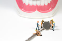 People and dental tool on white background Stock Image