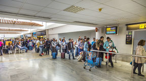 People in departure Hall in Airport stock photography
