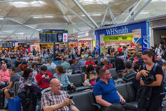 People at the departure lounge of London Stansted Airport Royalty Free Stock Photo