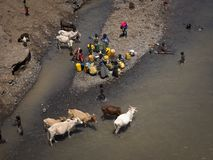 People from the Derasche tribe on the river stock photo
