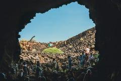 People descend into a Cave Cueva de los Verdes, volcanic cave in Lanzarote Royalty Free Stock Photos