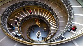 People descend the modern double helix staircase designed by Giuseppe Momo, Vatican Museums stock video footage