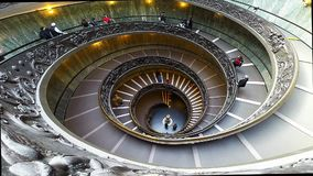 People descend the modern double helix staircase designed by Giuseppe Momo, Vatican Museums stock footage