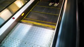 People descend from a moving escalator on the rise. stock footage