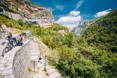 People descend the stone steps to the mountain river Le Verdon i Royalty Free Stock Images