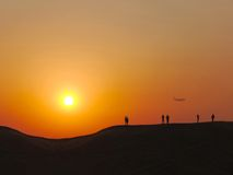 People in the desert at the sunset Stock Photography