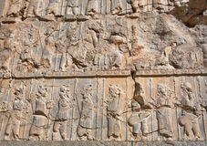 People on the destroyed stone bas-relief in Persepolis Royalty Free Stock Images